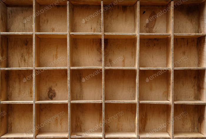 Empty wooden cabinet with cells