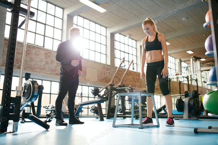 Woman exercising with a personal trainer