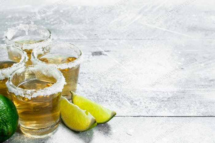 Tequila with lime wedges.