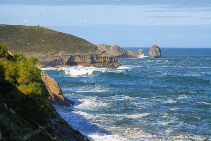 Wild cliffs and ocean in Llanes village