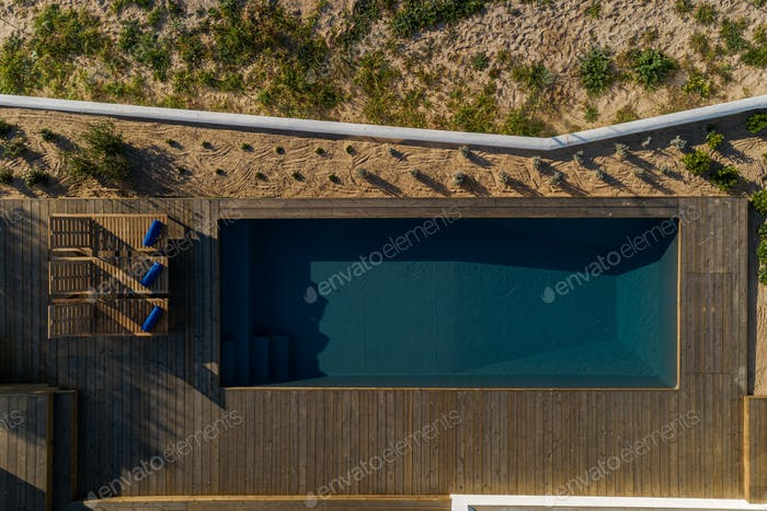 Aerial view of modern villa with pool and deck