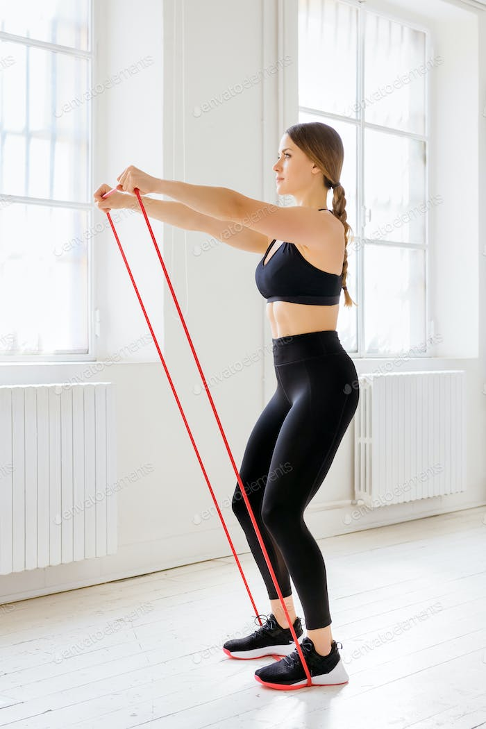 Woman athlete training with a power band