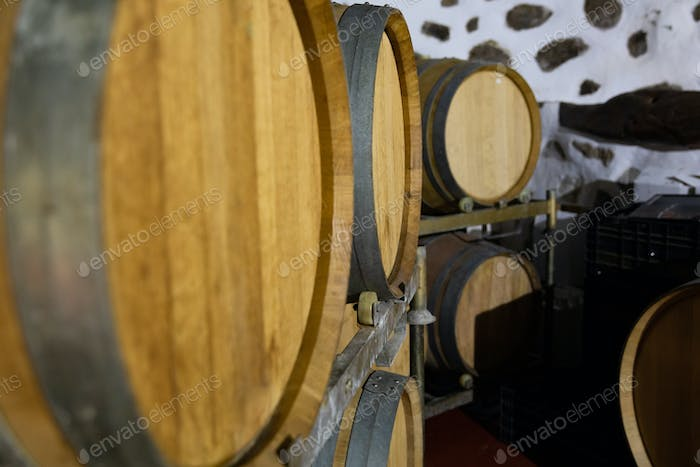 Close-up of Wooden Barrels in oak Stored At Wine Cellar