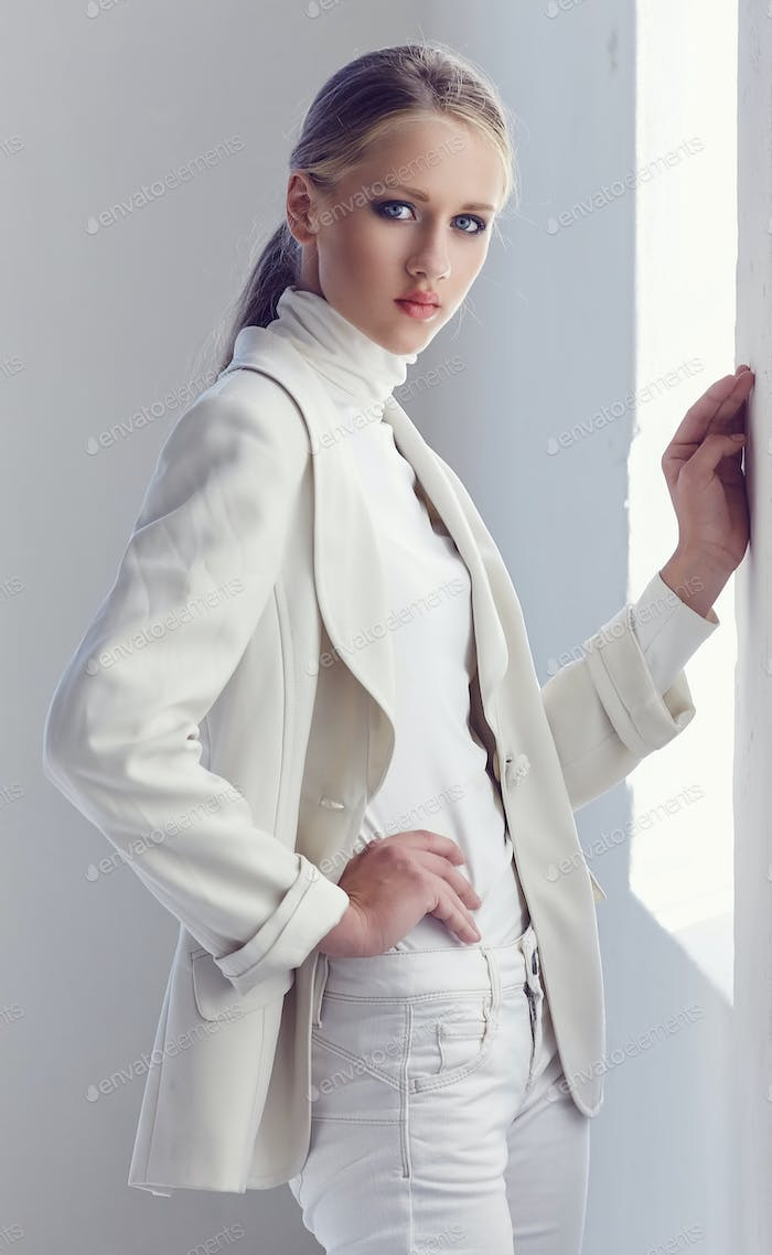 Blue eyes woman in a white spring clothes.
