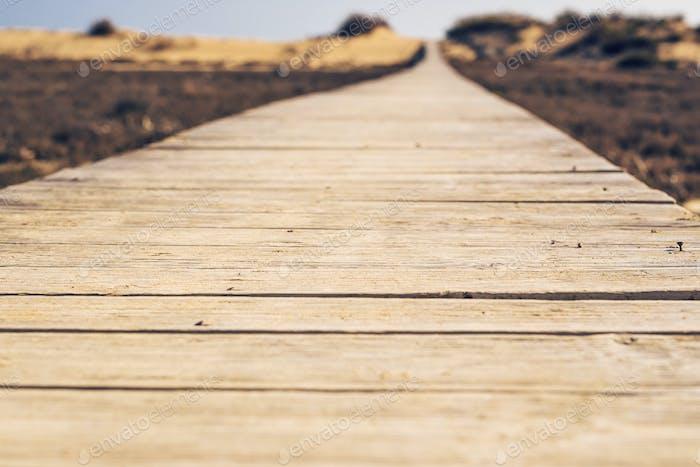 Close-up of wooden beach boardwalk path