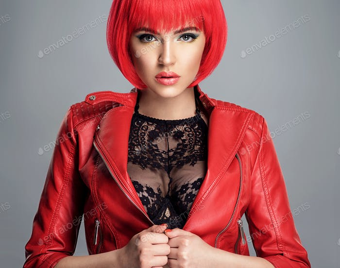 Beautiful sexy woman with bright red bob hairstyle.