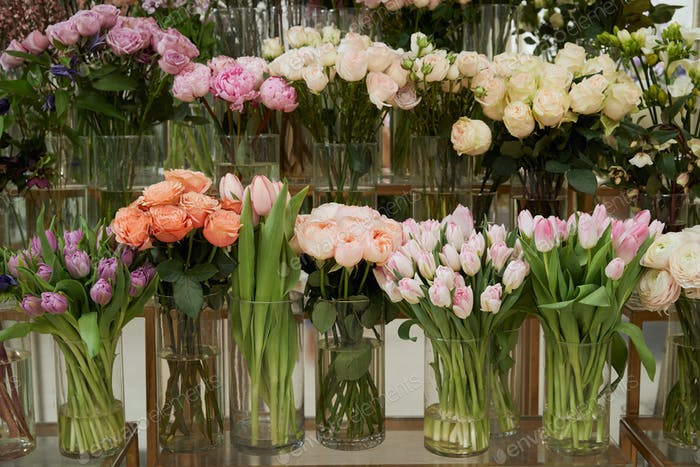 roses, tulips and peonies in glass vases