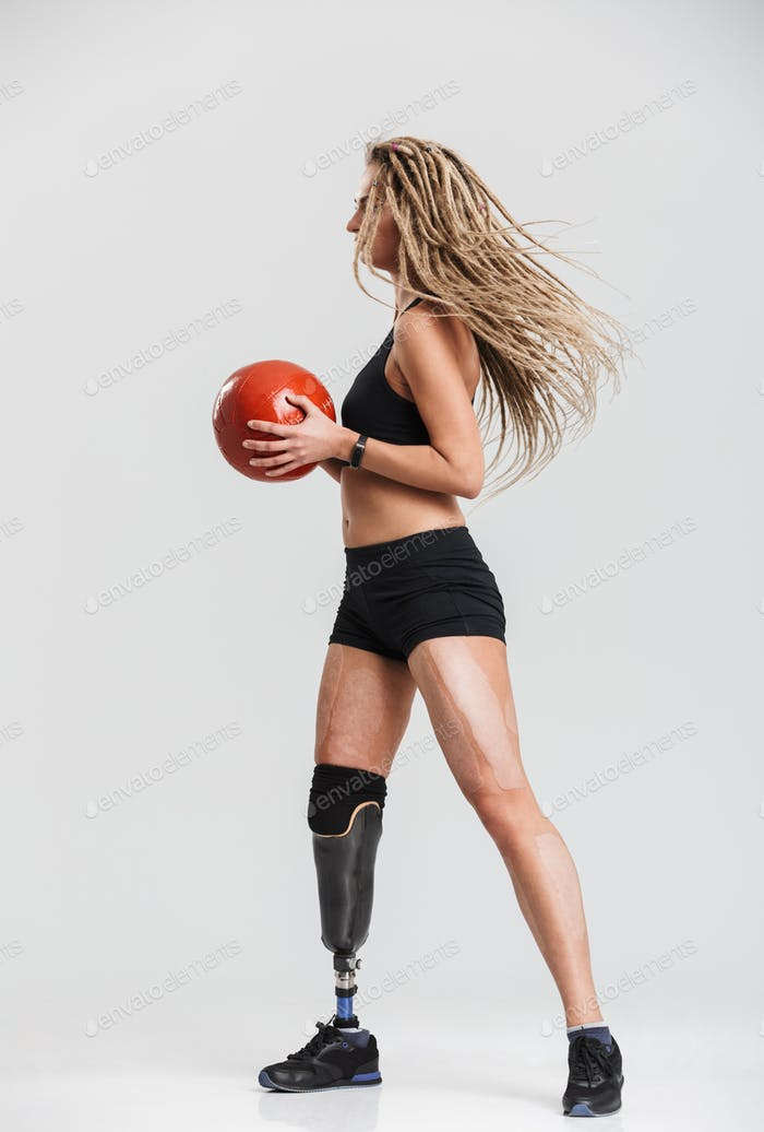Disabled sportswoman isolated make exercises with ball.