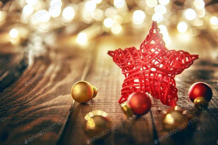 Christmas baubles on wooden background.