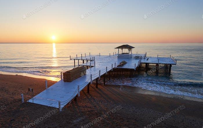Wooden pier on a fancy orange sunset