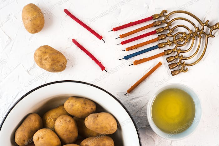 Thumbnail for Hanukkah, olive oil and potatoes on a white background