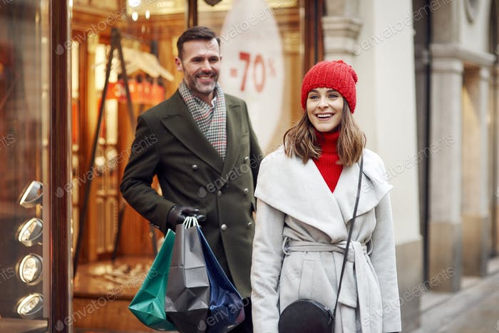 Cheerful couple during Christmas shopping