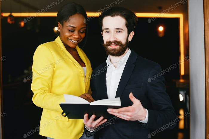 Stylish businessman working in a office with partner