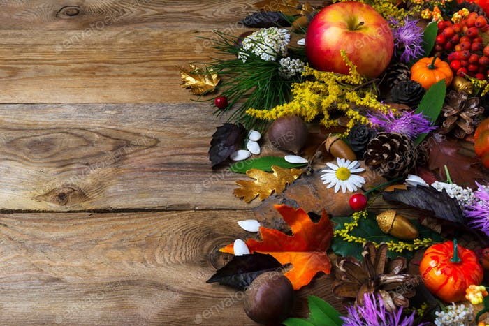 Fall greeting with cones and leaves on wooden table