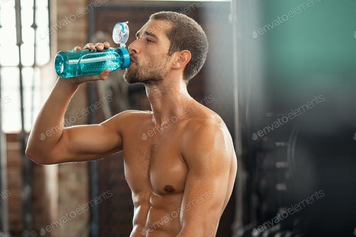 Fitness man drinking from water bottle