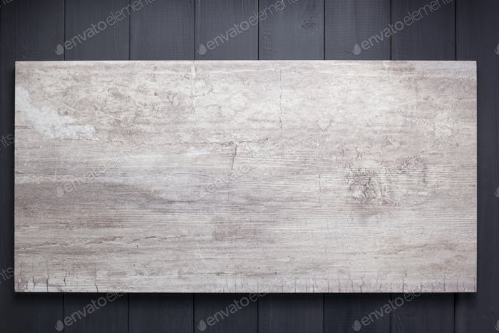 stone background at black wood