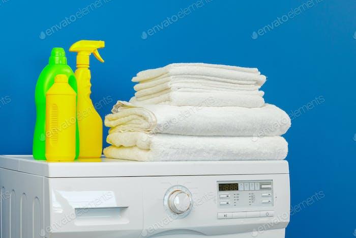 Bottle of detergent whith washing machine, indoors