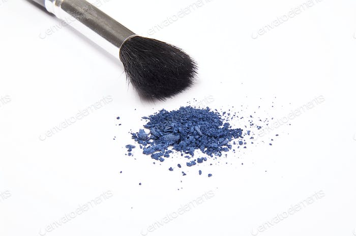 Cosmetic powder and black brush isolated