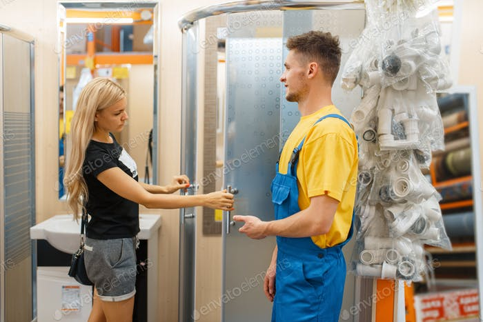 Assistant and female consumer in hardware store