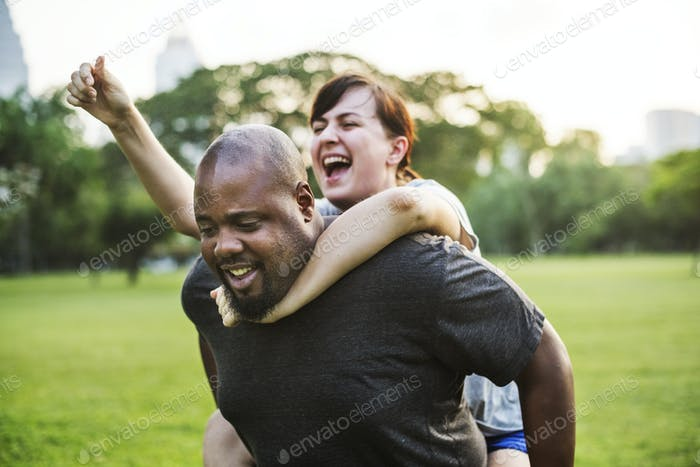 Couple having fun together at the park