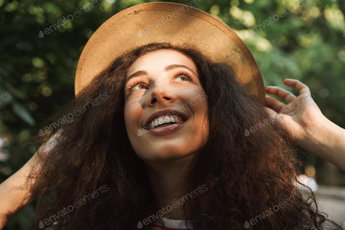 Portrait closeup of pretty young woman 18-20 with curly brown ha
