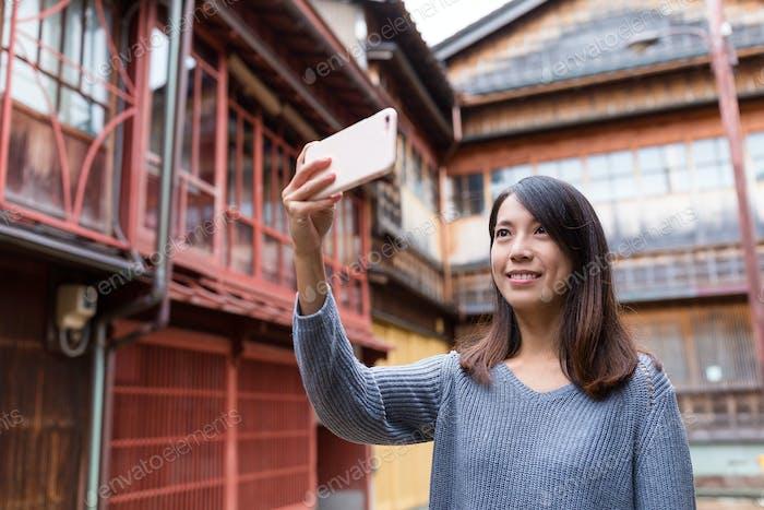 Woman travel in Kanazawa and taking selfie by smart phone
