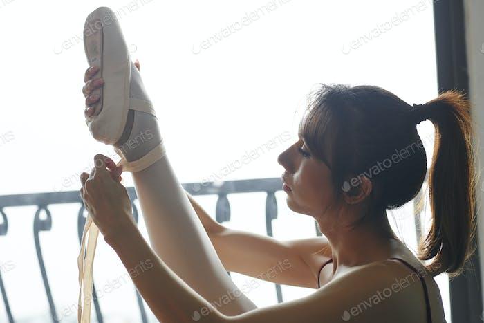 Dancer wearing ballet slippers