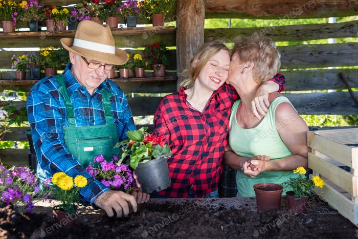 Happy family planting flowers together.