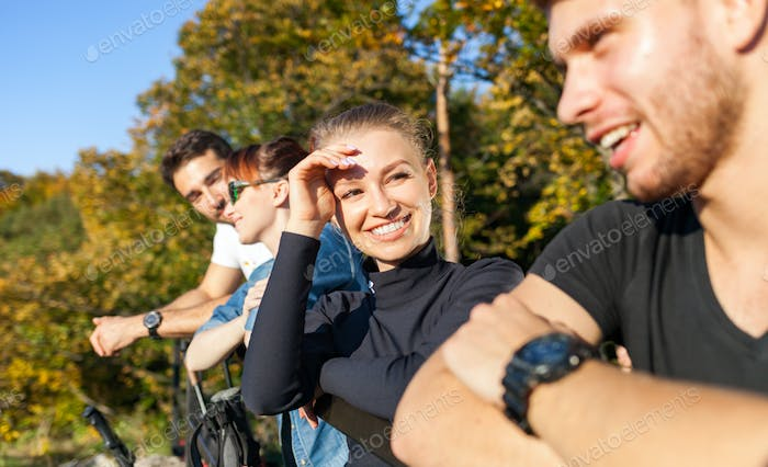 Group of friends on tourist trip looking at landscape