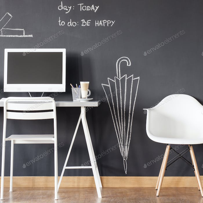 Room with blackboard wall and desk
