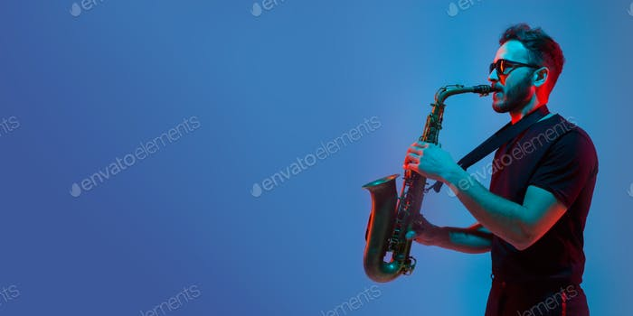 Young caucasian jazz musician playing the saxophone in neon light, flyer