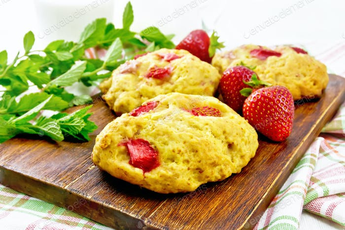 Scones with strawberry on light board