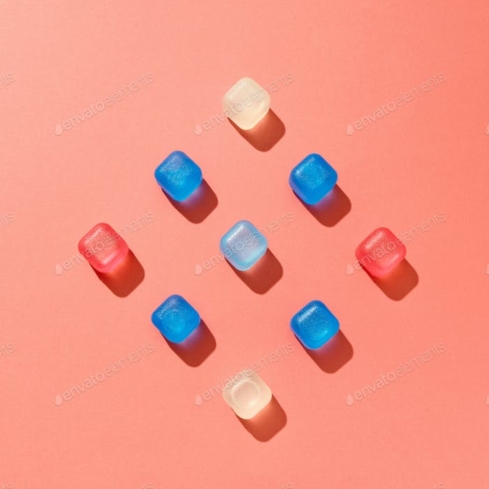 Simmetrical square composition from colored plastic cubes on a background in a color of the year