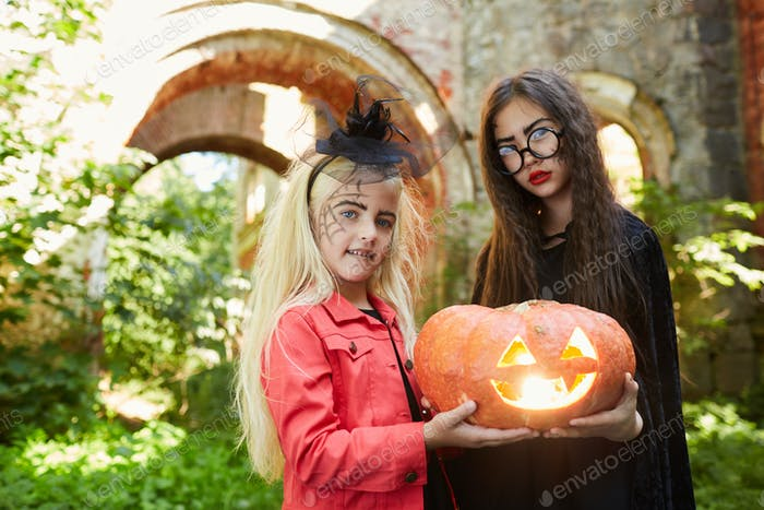 Little Girls Holding Pumpkin Lantern