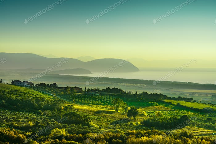 Maremma sunset panorama. Countryside, sea and Elba on horizon. S