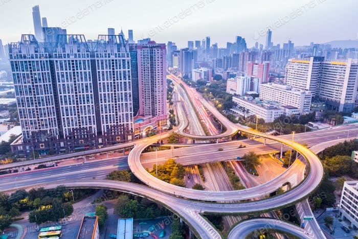 a highway interchange in guangzhou at dusk
