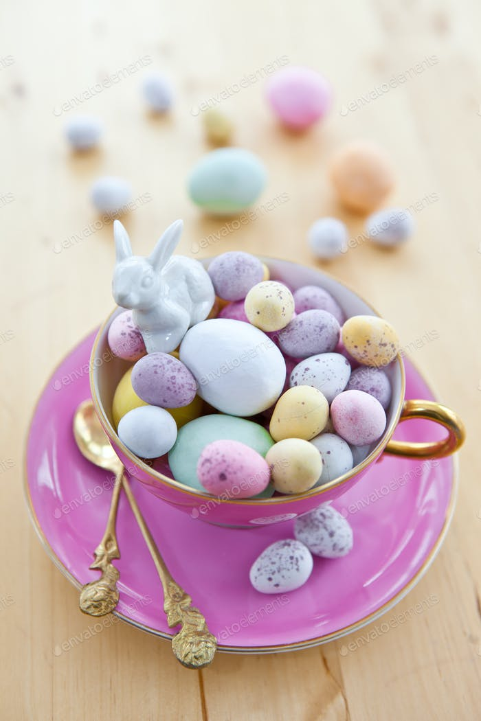 Pink vintage cup with easter eggs