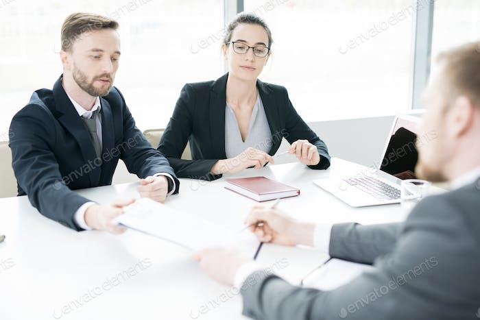 Business People Discussing Deal