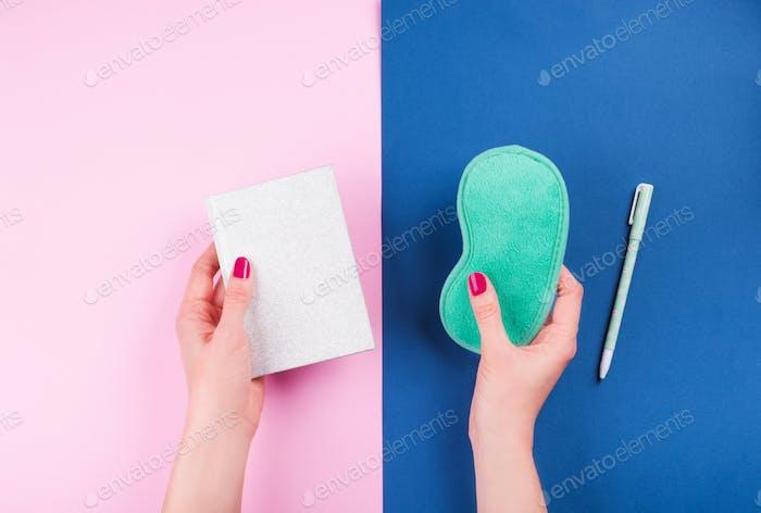 Sleeping mask and sleep journal with female hands