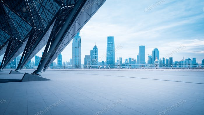 empty square floor with blue tone cityscape of tianjin skyline