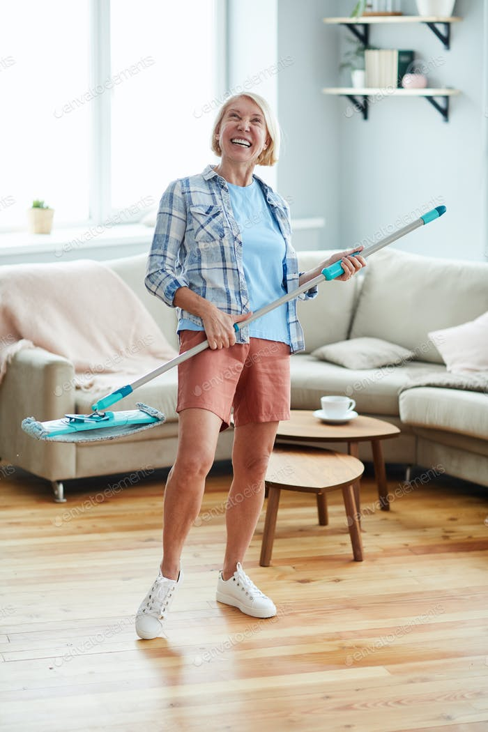 Excited woman enjoying housekeeping