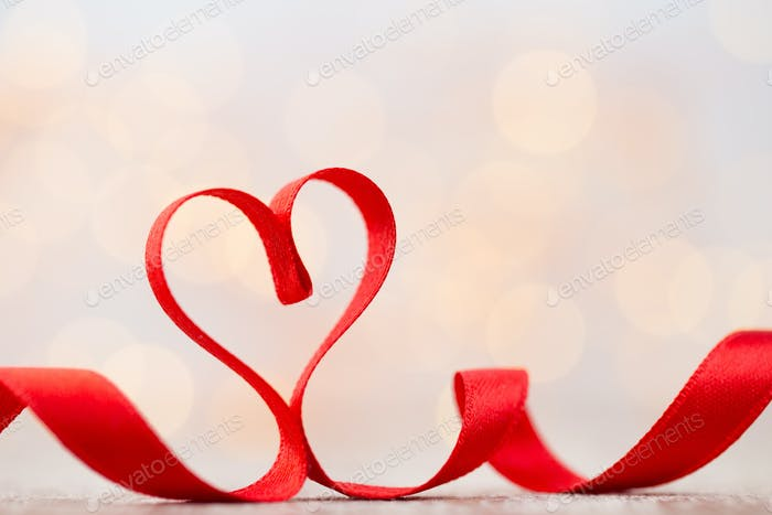 Red heart of ribbon. Valentines day background.