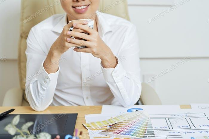 Freelance Graphic Designer Drinking Coffee
