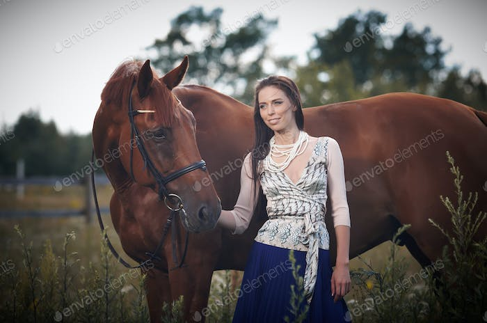 Woman and brown horse.