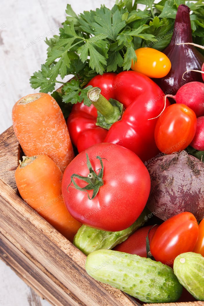 Heap of fresh vegetables as ingredients containing vitamins and minerals using for cooking dishes
