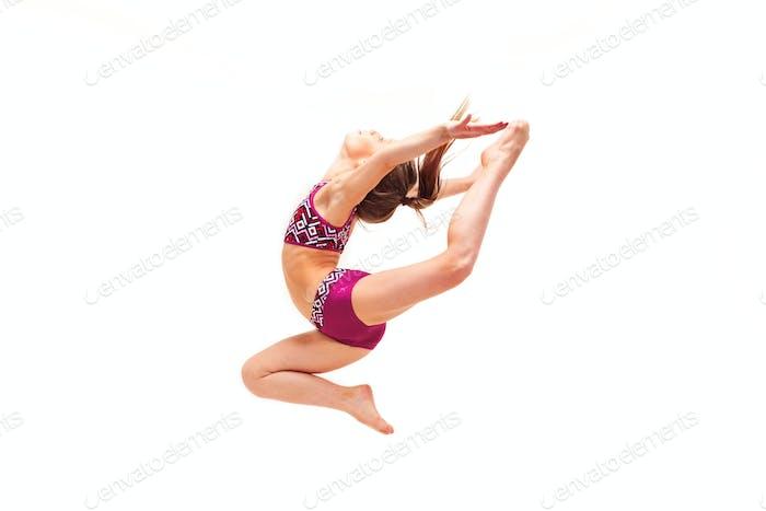 The teenager girl doing gymnastics exercises isolated on white background