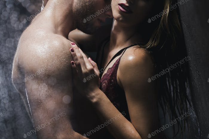 Man touching woman in the shower