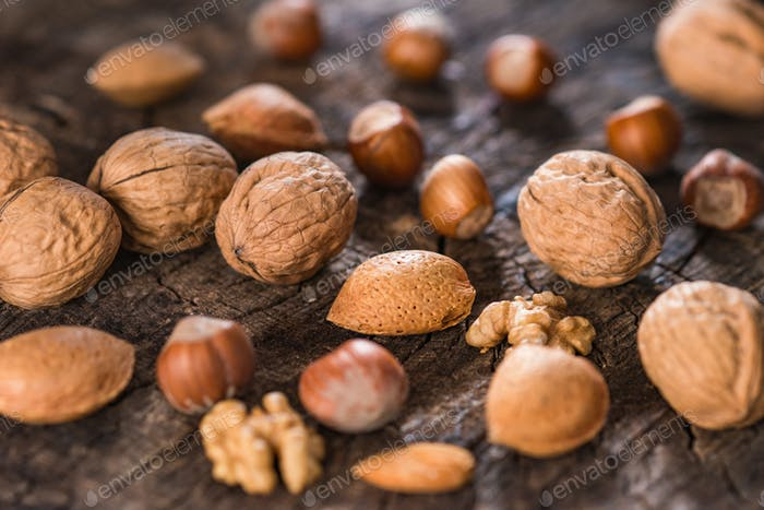 Mixed Nuts on Rustic Wooden Table
