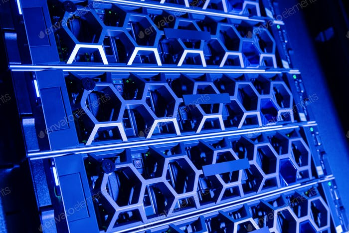 Closeup Of Modern Hard Drives In Illuminated Blue Datacenter
