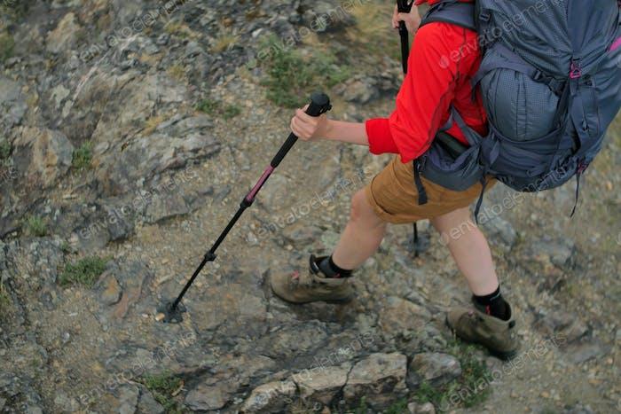 female hiker walking on a trail